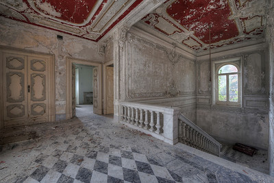 Checkerboard - Even in a derelict state this villa look stunning. The checkerboard floor and marble staircase are a bit dusty but still wonderful.