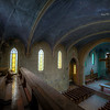 The Blue Chapel - Chapel of an abandoned monastery. Eerie blue light shines through the stained glass windows and illuminates the old altar.