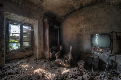 White noise - Vintage television left behind in a derelict abandoned villa